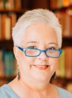 cropped-sheila-athens-cropped-blue-glasses-books-behind1.jpg
